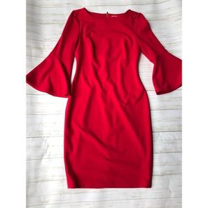 Red Calvin Klein form fitting dress w/bell sleeves